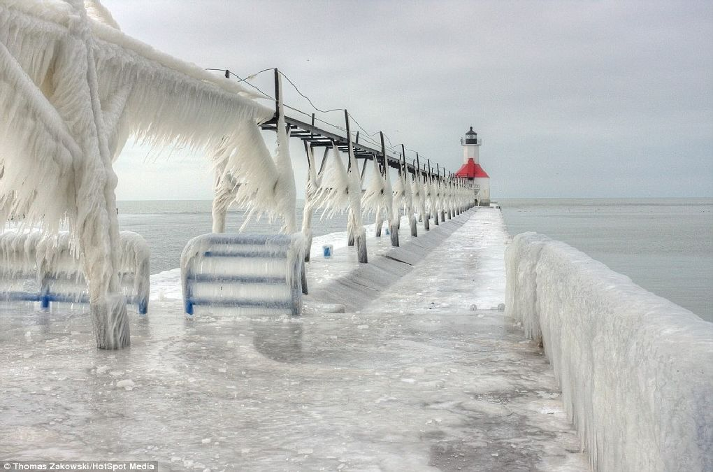 Nature's beauty: The lighthouses and their piers were frozen solid by the waves that came crashing down and then froze